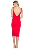 Back view of model wearing ladies midi knit Ponte red sleeveless dress with adjustable straps, sweet heart neckline, low back, and large bow at back waist.