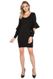 Model wearing body con little black dress in knit Ponte with novelty cuffed bell sleeves.