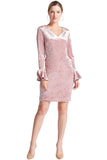 Model wearing pink stretch velvet short dress with v-neckline, long sleeves & bell sleeves.