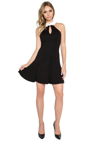 Model wearing sleeveless fit and flare black knit Ponte tuxedo dress with racer neck, keyhole & contrast white collar.