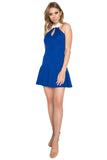 Model wearing fit and flare sleeveless blue knit Ponte dress with racer neck, keyhole & contrast white collar.