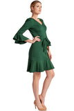 Model wearing green knee length v-neck knit Ponte dress with 3/4 bell sleeves, ruffle hem and self belt.