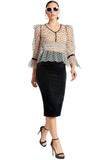 Model wearing white mesh black polka dot 3/4 puff sleeve peplum hem v-neck top with black velvet buttons and bows paired with black velvet pencil skirt