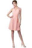 Model wearing sleeveless peach short fit and flare wing tip collar dress with corset lace up ties at front waist.