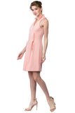 Model wearing sleeveless racer neck peachy pink short fit and flare wing tip collar dress with corset lace up ties at front waist.