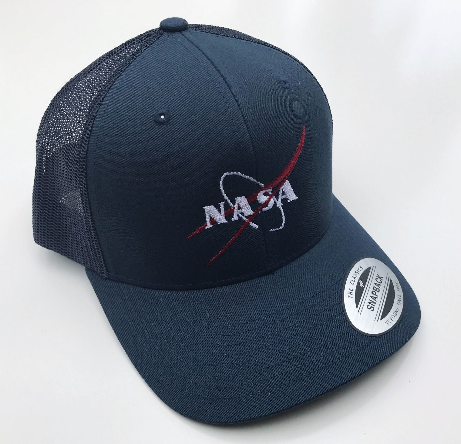 Shop NASA Vector Logo Trucker Cap - NEW for 2017! Online from The ... 8b6c32a4cba1