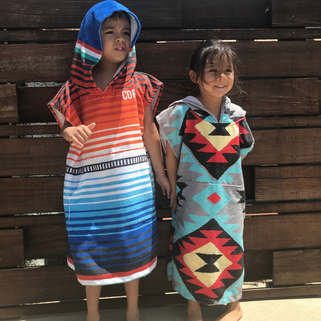 Kids Changing Poncho - Sarape