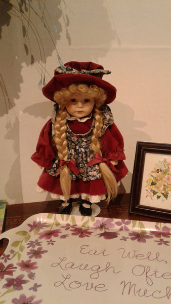 Porcelain Doll on a Stand