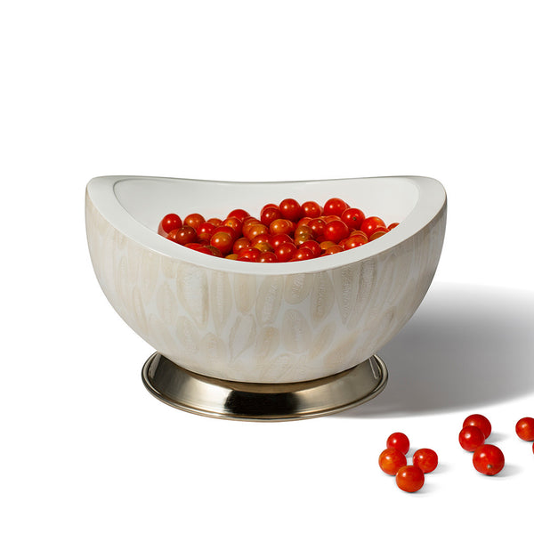 handmade almendro wood accent bowl with off-white pattern and base containing fresh cranberries