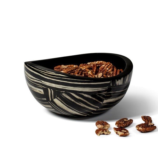 handmade black and white striped ebano veneer wood accent bowl containing pecans inside