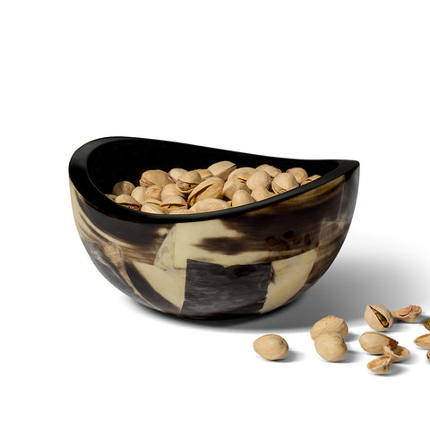 handmade horn veneer accent bowl with brown and beige geometric pattern containing pistachios