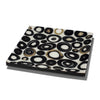 handmade horn veneer white small platter with several black and beige rings