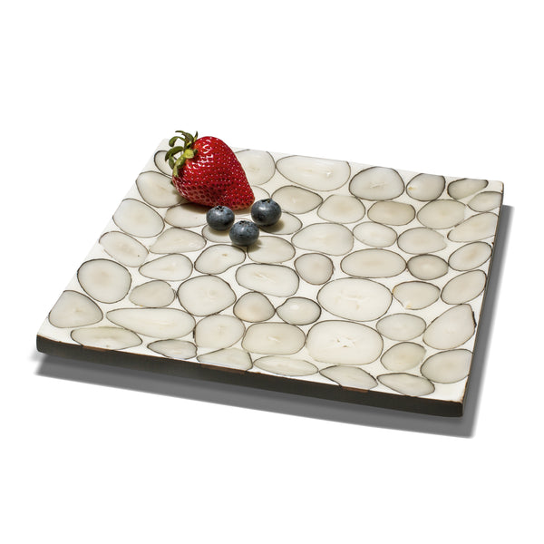 handmade beige and gray tagua seed pattern small platter with one strawberry three blueberries