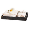 handmade black and beige splatter horn veneer wood bath tray with towels and flower