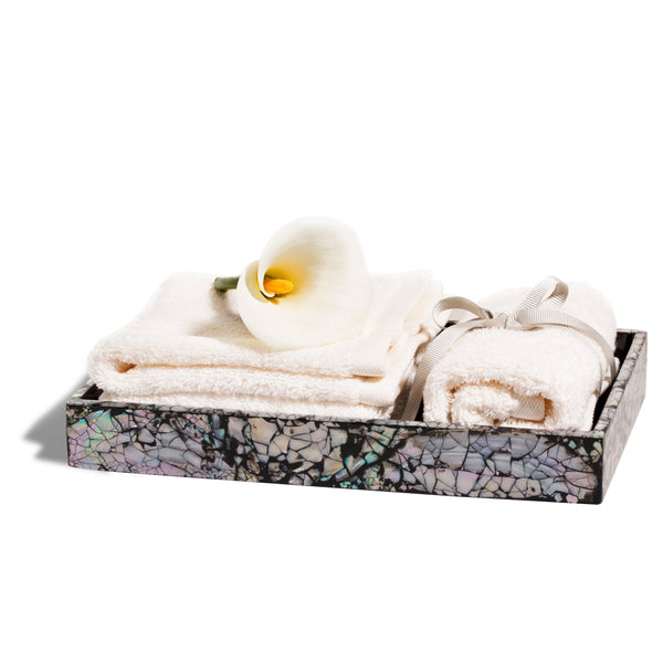 handmade iridescent mother of pearl wood bath tray with towels and flower inside