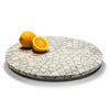 handmade tagua seed round white and grey pattern on wood round lazy susan revolving tray with oranges on top