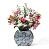 handmade iridescent mother of pearl mosaic on black wood flower vase with flowers inside