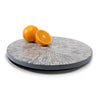 handmade gray round lazy susan with white bone inlay in floral pattern with oranges on top
