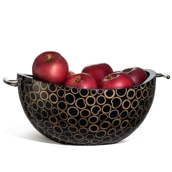 handmade light brown bamboo rings on black serving bowl with black wood interior and silver handles containing red apples