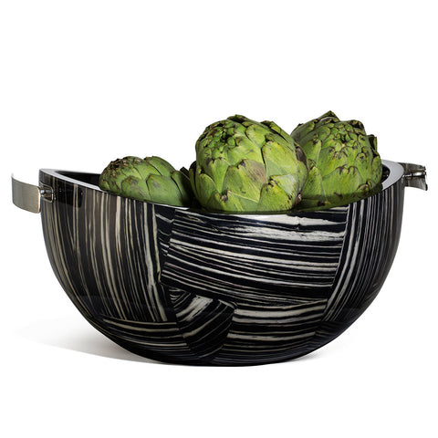 handmade black wood serving bowl with cream geometric stripe pattern and two german silver handles containing artichokes