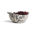 handmade cream and black spotted ojo de pajaro serving bowl with two c-shaped german silver handles and cherries