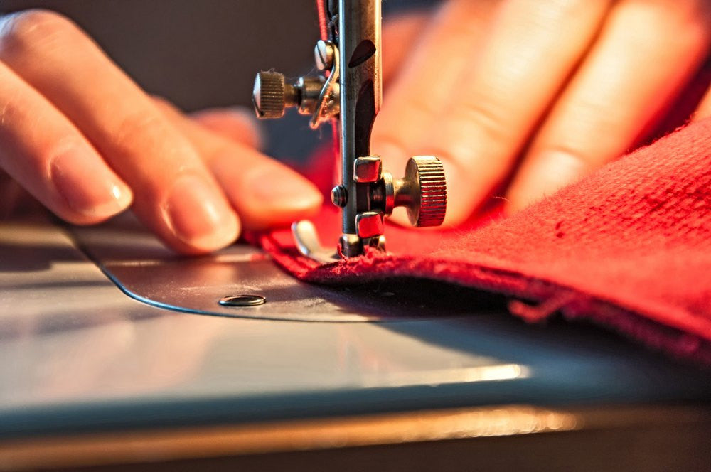 sewing red fabric