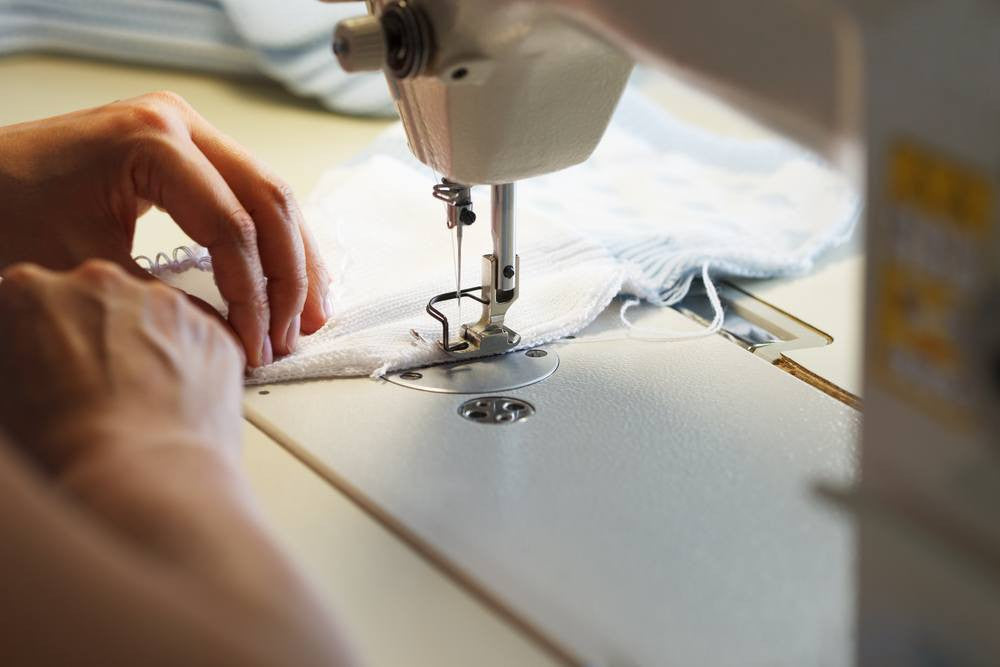 sewing white fabric