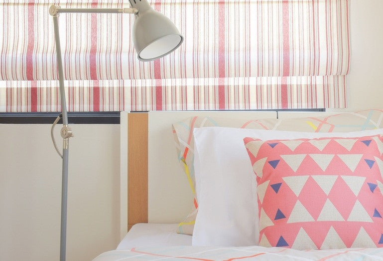 pink bedding and blinds