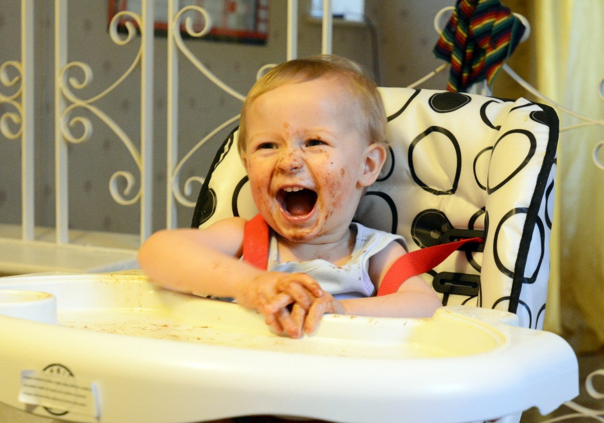 messy child in high chair