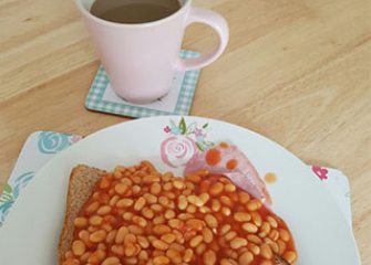 Beans on toast and a cup of coffee