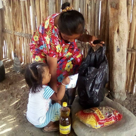 Wayuu mother receiving food and water