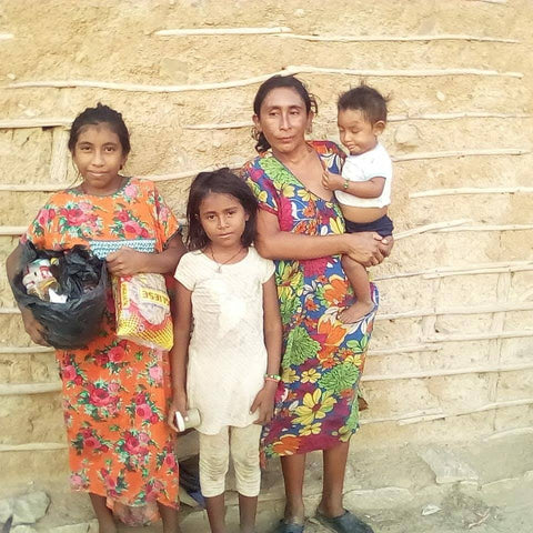 Wayuu family receiving food and water