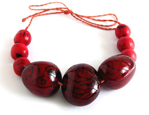 red organic vegan necklace from tagua palm tree Colombia luloplanet
