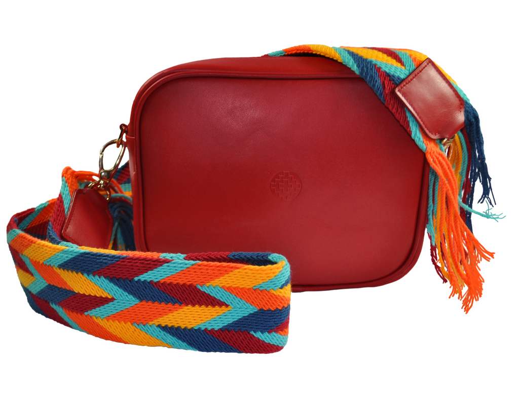 red leather messenger bag with removable handwoven Wayuu strap