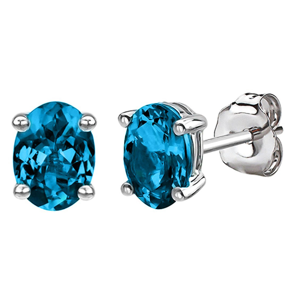14 KARAT WHITE GOLD BLUE TOPAZ OVAL. Choose From 0.25 CTW To 10.00 CTW