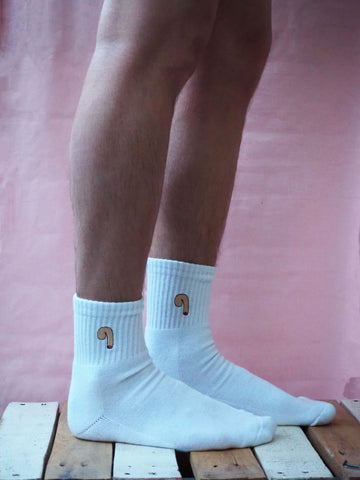 A lovely pair of legs a man wearing white cotton socks
