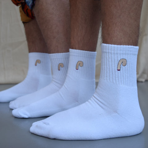 two men standing wearing white novelty socks