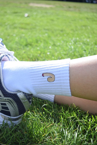 white novetly socks for adults on a grassy background