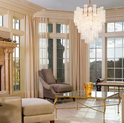 Cassian Chandelier by The Vault hanging in a luxurious living room