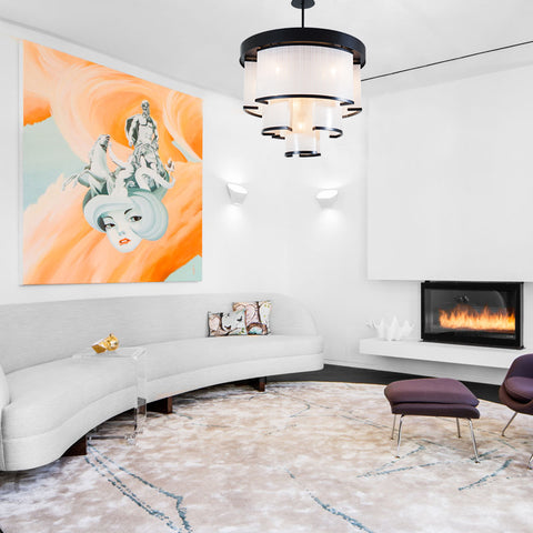 Treamine Linen Chandelier by The Vault hangs over a minimalist style living room