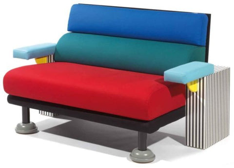 Rainbow colored chair designed by the Memphis Design Group