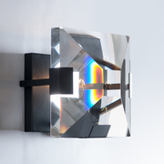 Side view of the Ann Arbour Glass Wall Sconce with a prism effect displayed in the glass