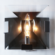 Close up view of the Ann Arbour Glass Wall Sconce, highlighting the light from the fixture
