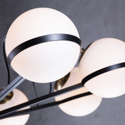 The matte black arms and white milk glass globes of the Alba