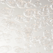Close up of the glass bubbles of the Bella Glass Bubbles Chandelier on a white background