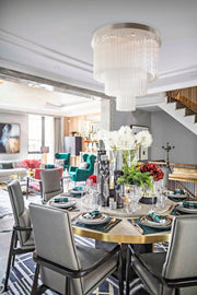 Jade Glass Chandelier shown installed over a dining room set