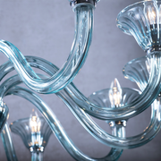 Close up of blue glass arms and LED bulbs of Marcella Blue Glass Chandelier