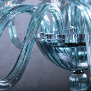 Close up of blue glass arms of Marcella Blue Glass Chandelier