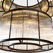 Detailed view of 2 tiered glass shades of the Valen Antique Black Round Chandelier
