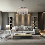Astoria Crystal Chandelier installed in a modern decor living room centered over sofa and coffee table